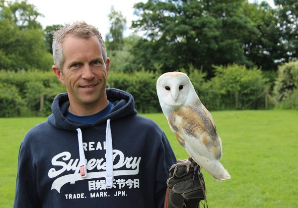 Customer holding Barn Owl